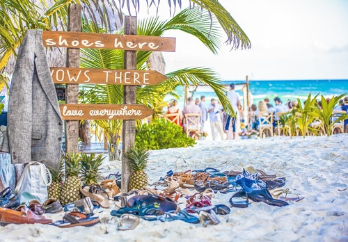 6 cool beach wedding decor ideas that youll want to steal say yes to a beach shoe station junglespirit Gallery