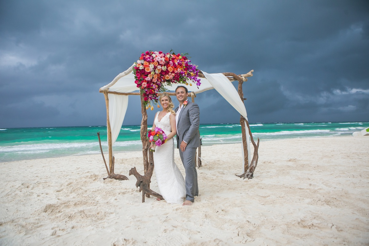 the bride's guide for coping with a rainy beach wedding: 7 essential tips